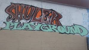 Painted Wall that says Shuler Playground
